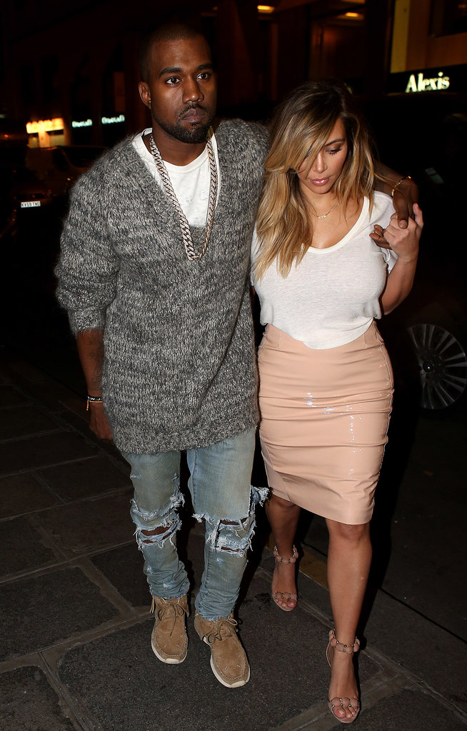 Kanye West kept his arm around Kim Kardashian when the couple went to dinner at Hotel Costes on Monday.