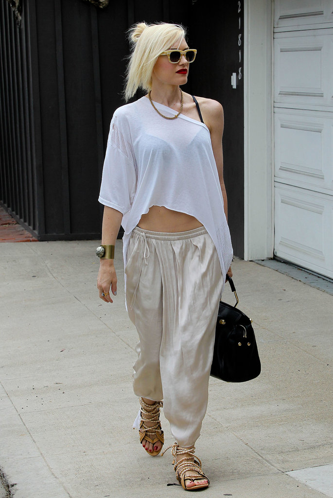 She topped her sheen harem pants with an asymmetrical tee and striped shades for a beach day in Malibu in July 2013.