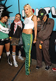 Only Gwen could work Adidas track pants and a cropped graphic tank with pointed leopard pumps.