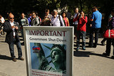 Visitors in NYC snapped pictures of a sign that said the Statue of Liberty would be closed.