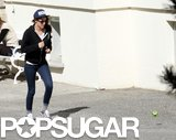 Kristen Stewart jogged to grab the ball she was playing with.
