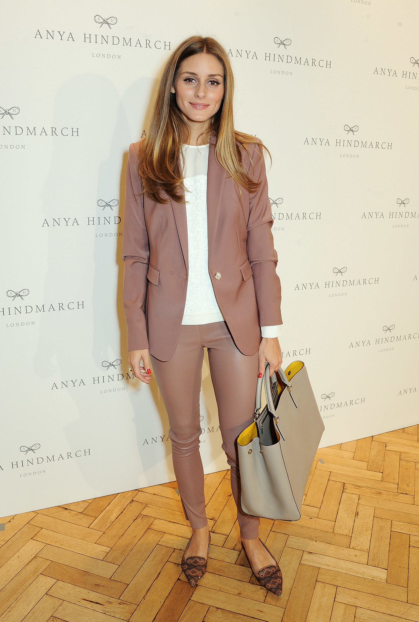 At Anya Hindmarch, Olivia took a neutral approach, matching a sleekly tailored blazer with coordinating leather pants.
