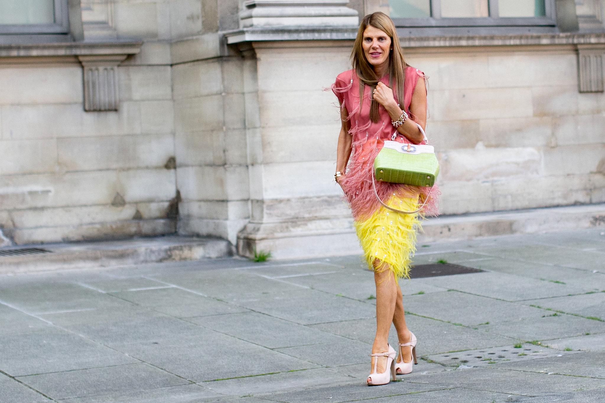 Anna Dello Russo ruled the sidewalk in multicolored feathers.