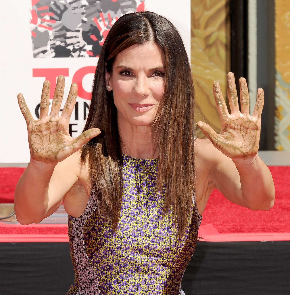 To celebrate her latest film, Sandra was honored with a hand- and footprint ceremony at the TCL Chinese Theatre. She keep things daytime chic with a slightly askew side part, straight hair, and rosy lips and cheeks.