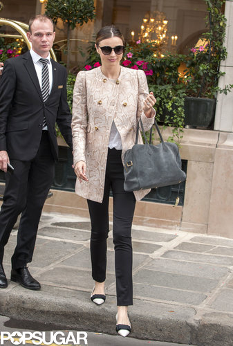 Miranda matched black Frame Denim jeans with a luxurious animal-print coat and two-tone flats in Paris.