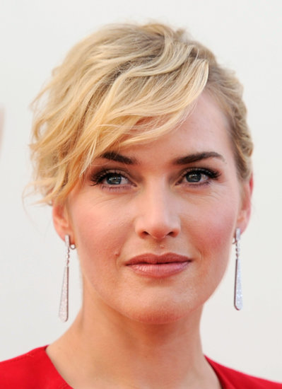 We love this sexy sideswept updo she wore to the 2011 Emmy Awards. And that smoky eye? Perfection.