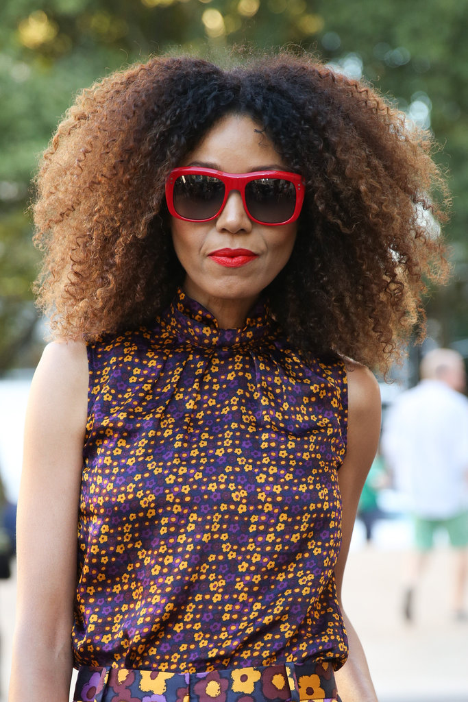 Blown-out, natural curls couple wonderfully with a bright red lipstick.