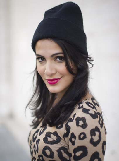 Fuchsia lips, a beanie, and a leopard-print top combined to form this cool-girl style.