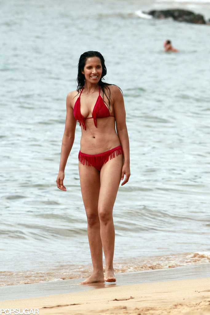 Padma Lakshmi flaunted her figure in a red bikini while vacationing in Hawaii.