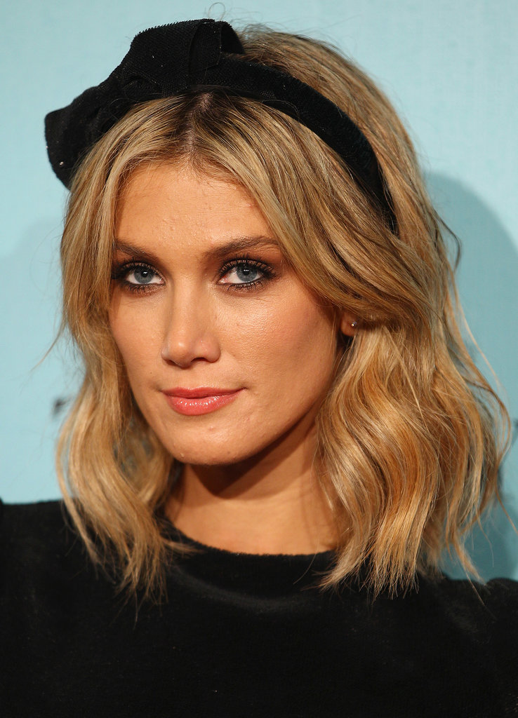 Adding a velvet headband to beachy waves converts the Summer style into a cold-weather look, like Delta Goodrem did here.