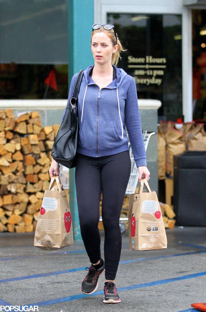 Emily Blunt's growing baby bump could be seen under her sweatshirt.
