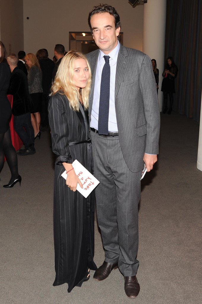 Mary-Kate Olsen and Olivier Sarkozy made a pinstriped pair at Sotheby's Take Home a Nude benefit.