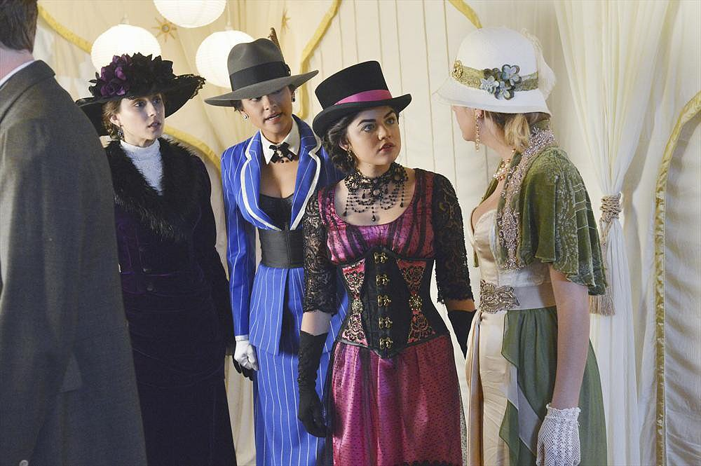 Aria stood out in a pretty pink gown featuring a corset bodice and black lace overlay.  She accessorized her Victorian ensemble with a dark dripping choker, top hat, and black satin gloves. Photos courtesy of ABC Family