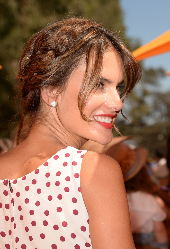 Alessandra Ambrosio showed off the perfect pairing for a red lip: a piecey milkmaid braid.