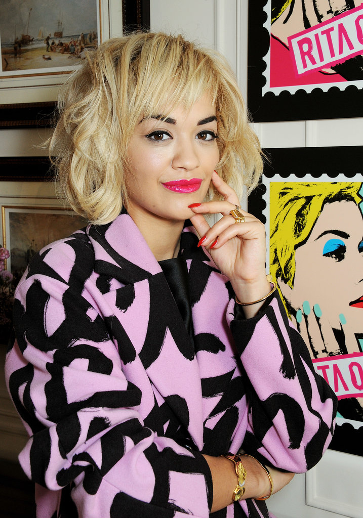 When we think of fun, exciting beauty, it's Rita Ora that comes to mind. At the Rimmel London 180 Years of Cool photocall, she chose pink as her color for lips and nails; her shoulder-length hair had piecey volume.