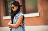 A backwards cap looks quite cool up against a grungy style.