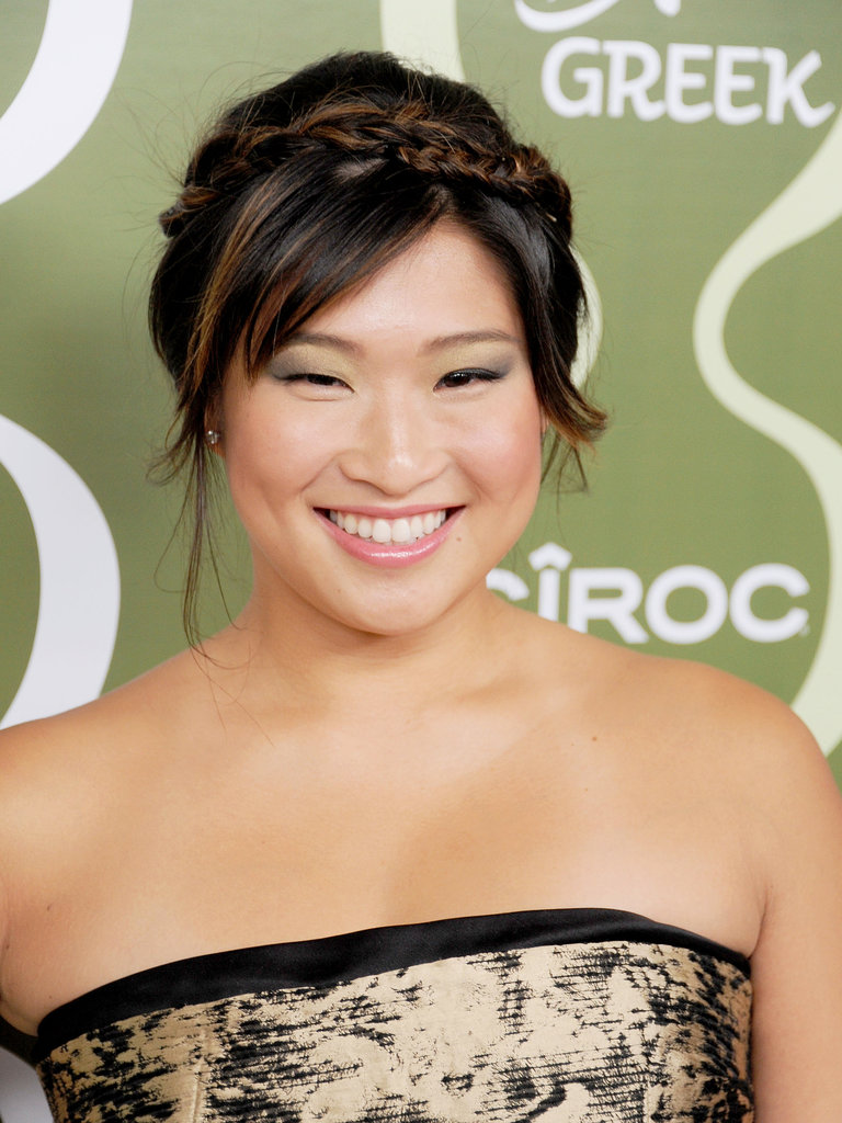 Wispy bangs and petite crown braids made for a romantic look on Jenna Ushkowitz.