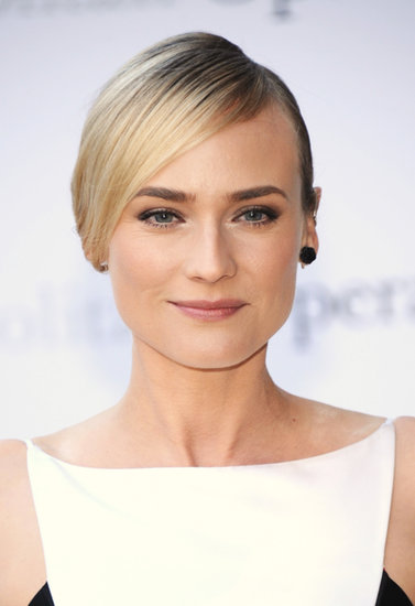 Already have sleek strands? Pull your straight hair back into a low bun with a dramatic, deep side part, letting the longer side drape over your ear like Diane Kruger did here.
