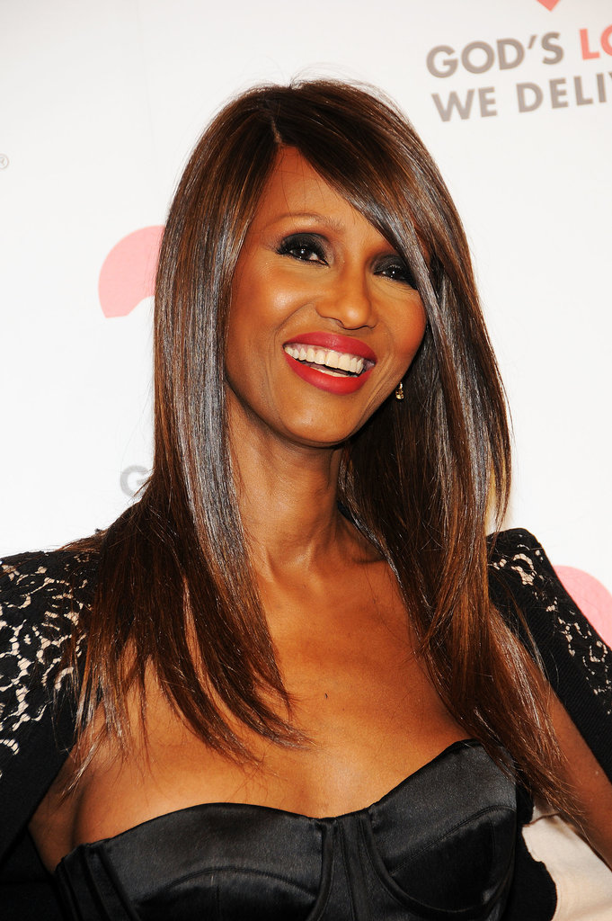 Iman looked drop-dead gorgeous with slick hair, red lipstick, and a dark smoky eye.