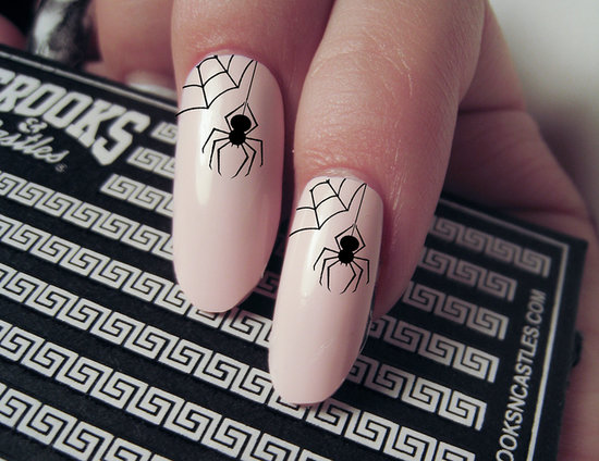 Add a dainty amount of Halloween to your nails with these hanging spider nail decals ($4 for a set of 20).