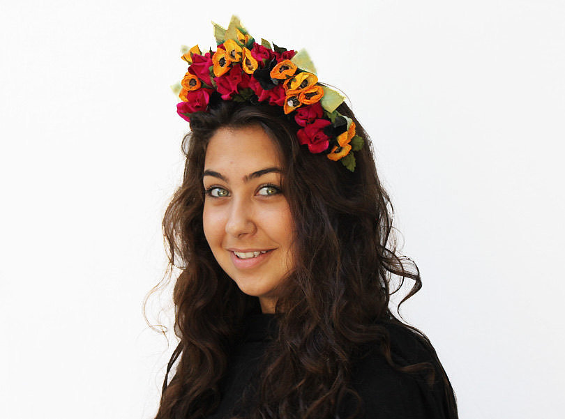 Take your Frida Kahlo costume up a notch with this floral head wreath ($45).