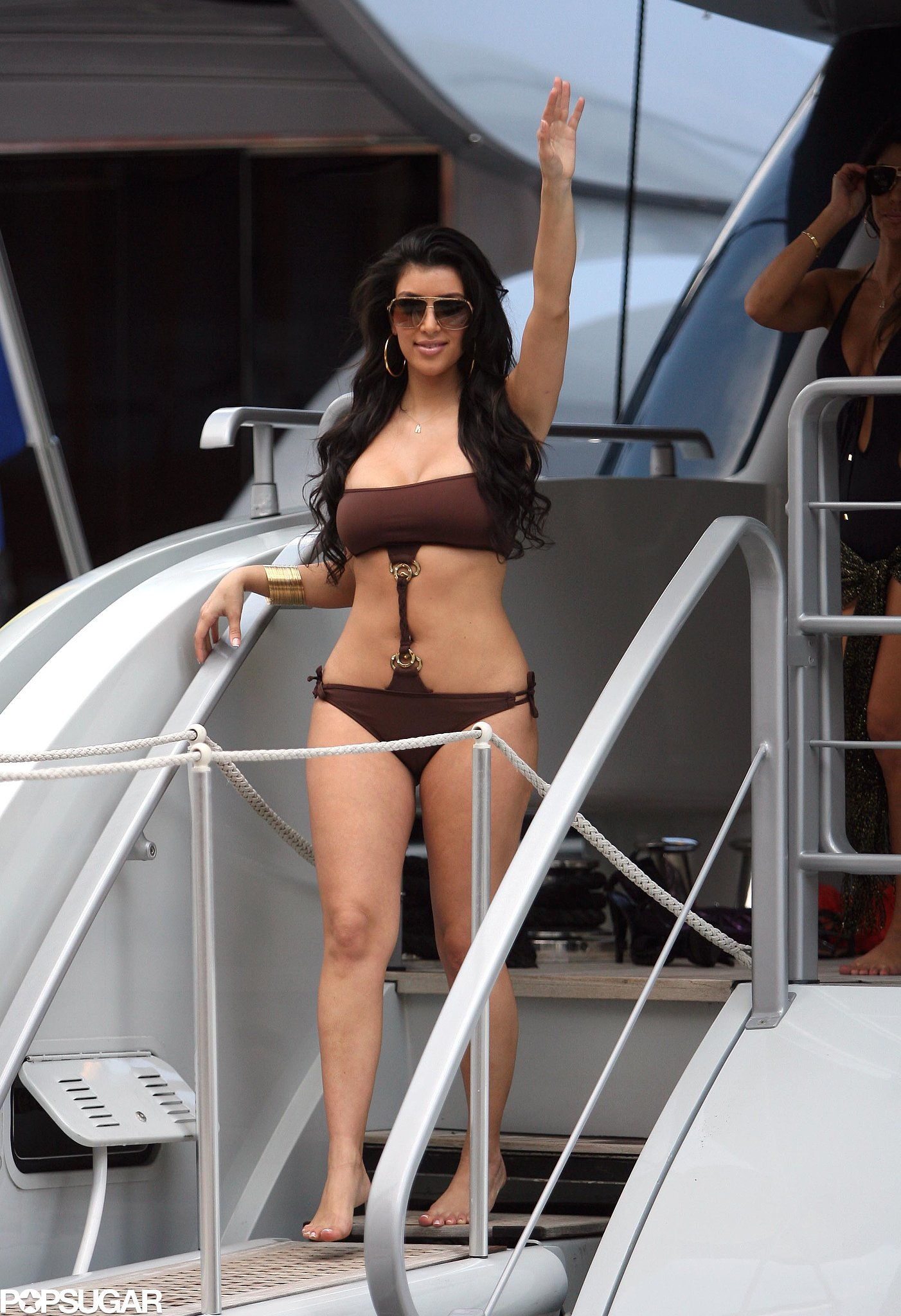 Kim Kardashian waved to the camera while vacationing in Monte Carlo in June 2008.