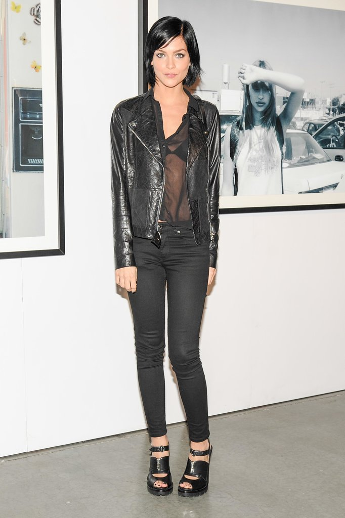Leigh Lezark stuck to her black uniform with a sheer topper and edgy leather heels at Vans' Spring presentation.