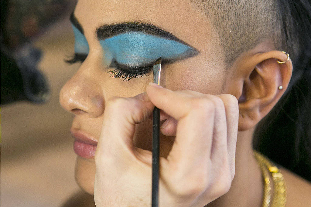 To create our version of Cleopatra's classic look, Bouchard next blended the turquoise color and black liner at the outer corner of the eye shape for a more modern take. Source: Caroline Voagen Nelson