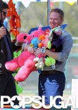 Jesse Tyler Ferguson clutched a bunch of stuffed animals on the LA set of Modern Family on Thursday.