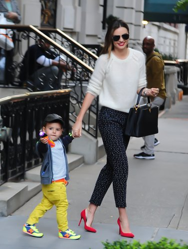 Miranda was spotted with her son, Flynn, while wearing a cozy white sweater paired with printed pants and bright red heels. She accessorized with an ultracovetable Louis Vuitton Capucines bag.