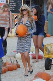 In LA, Paris Hilton carried a big orange squash.