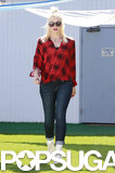 Gwen Stefani covered up her baby bump in this bold red and black plaid top by Aqua ($78). She finished with skinny denim and white high-top sneakers.