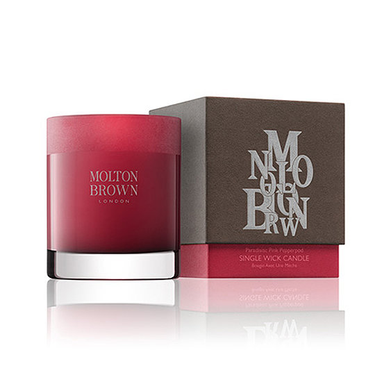 The warm red case of Molton Brown's Pink Pepperpod-Scented Candle ($49) —with scents like pink and black pepper, oakmoss, and patchouli — wraps up a perfect hostess gift.