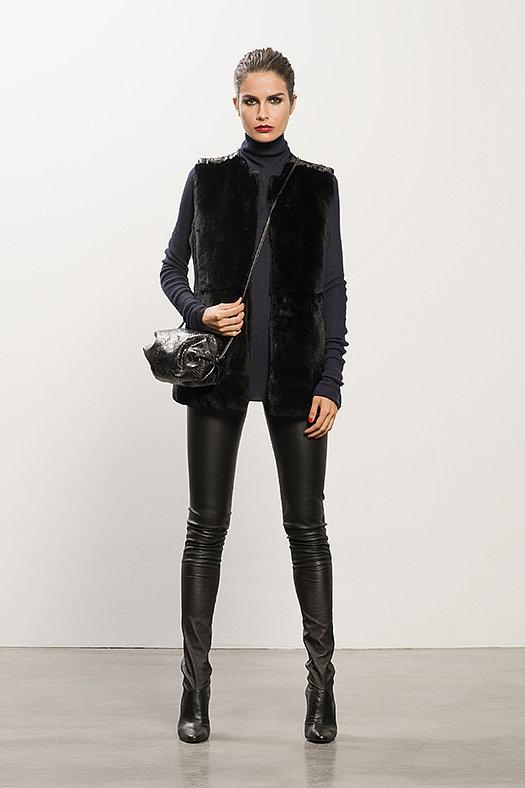 Rabbit Fur Black Vest ($995), Cashmere Navy Turtleneck Sweater ($495), Sweet Revenge Black Leather Legging Boot ($1,995), Sunset Watersnake Black Cross Body Bag ($625) Photo courtesy of Tamara Mellon