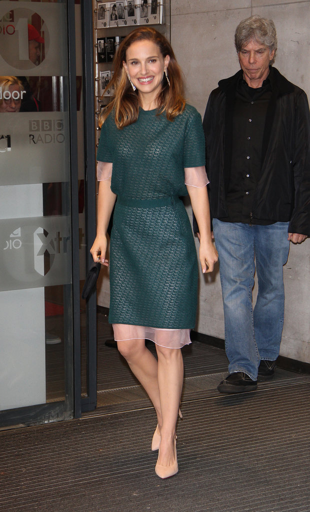 For her daytime promotional duties in London, Natalie Portman donned a green knit dress with nude Charlotte Olympia heels.
