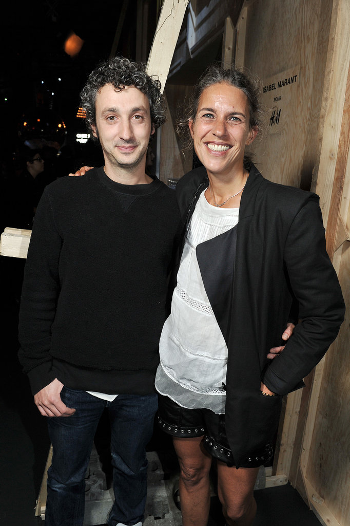 "The woman of the evening, Isabel Marant, stopped to pose with her designer husband, Jerome Dreyfuss. How do you say ""aw"" in French? Photo courtesy of H&M"