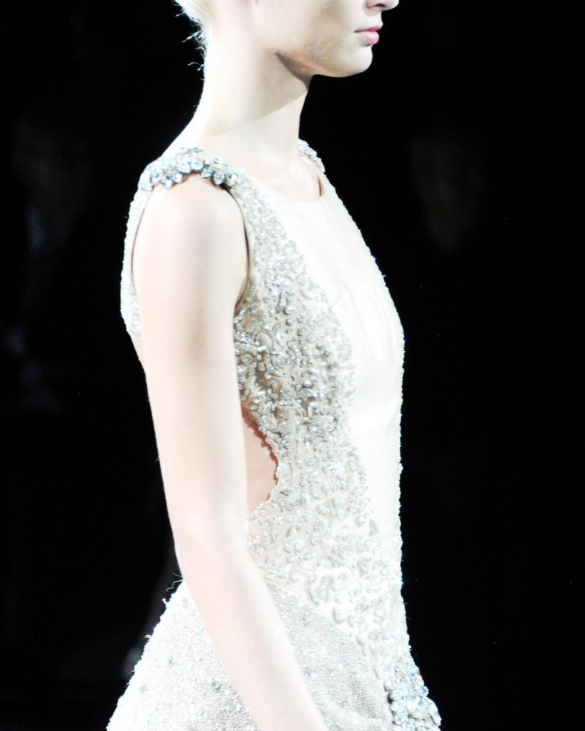 The beading on this dress gave it enough texture to prevent it from getting washed out by all the lights on the runway.