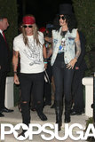 Cindy Crawford and her husband went as Guns 'n' Roses bandmembers Slash and Axl Rose to the Casamigos Halloween Party.