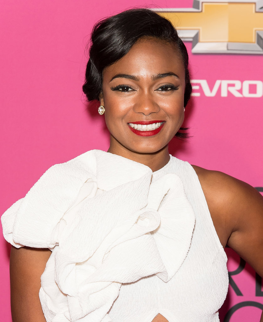 Tatyana Ali's winged liner and red lipstick are always classic options.