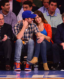 Olivia Wilde and Jason Sudeikis cuddled courtside during a Knicks game in May 2013.