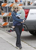 Amy Poehler cradled her son, Archie, at an LA farmers market.