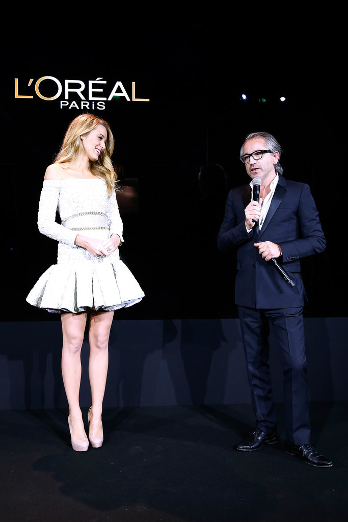 Blake Lively stood on stage with L'Oréal Paris CEO Cyril Chapuy.