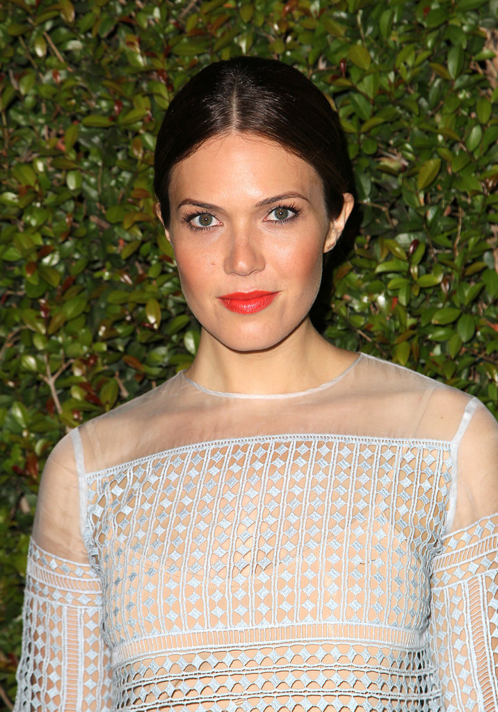 Mandy Moore could have gone with a soft makeup look to match her powder-blue dress, but the bright orange lipstick gave the ensemble a more modern edge.