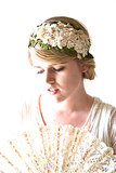 We love the feminine intricacies of this ivory and champagne flower crown ($70), which would be perfect for the boho bride.