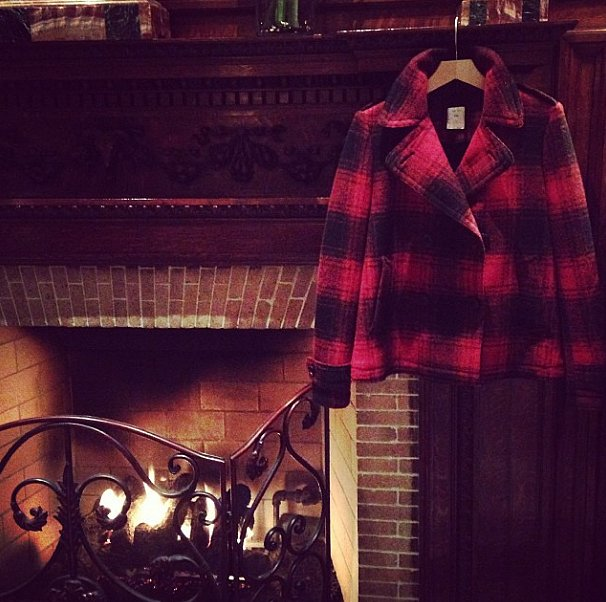 No better way to welcome the holidays than with a fire and plaid.