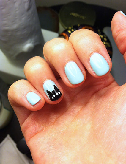 Halloween may be over, but there's no reason not to wear this black cat nail art any time of the year.  Photo: Kaitlyn Dreyling