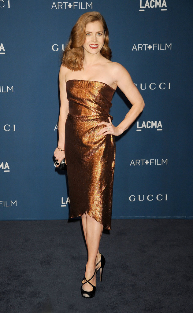 Amy Adams's bronze tulip-hem Gucci dress, paired with black patent-leather peep-toe pumps, perfectly matched her hair!