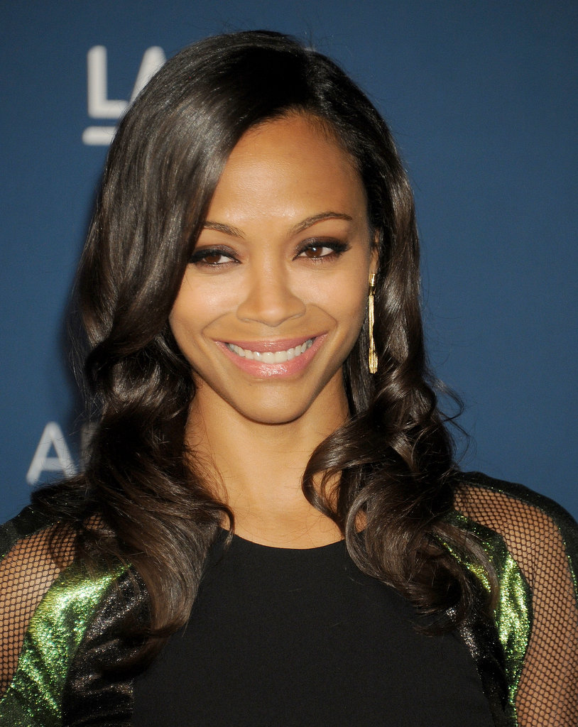 Zoe Saldana's moody, dark eye shadow couldn't detract from her bright smile on last night's red carpet.