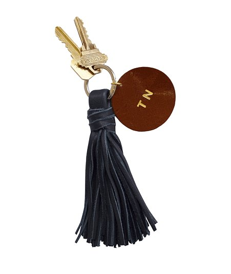 For a sweet option that won't break the bank, try Clare Vivier's tassel keychain ($60 with personalization) with a disc ready for customizing.
