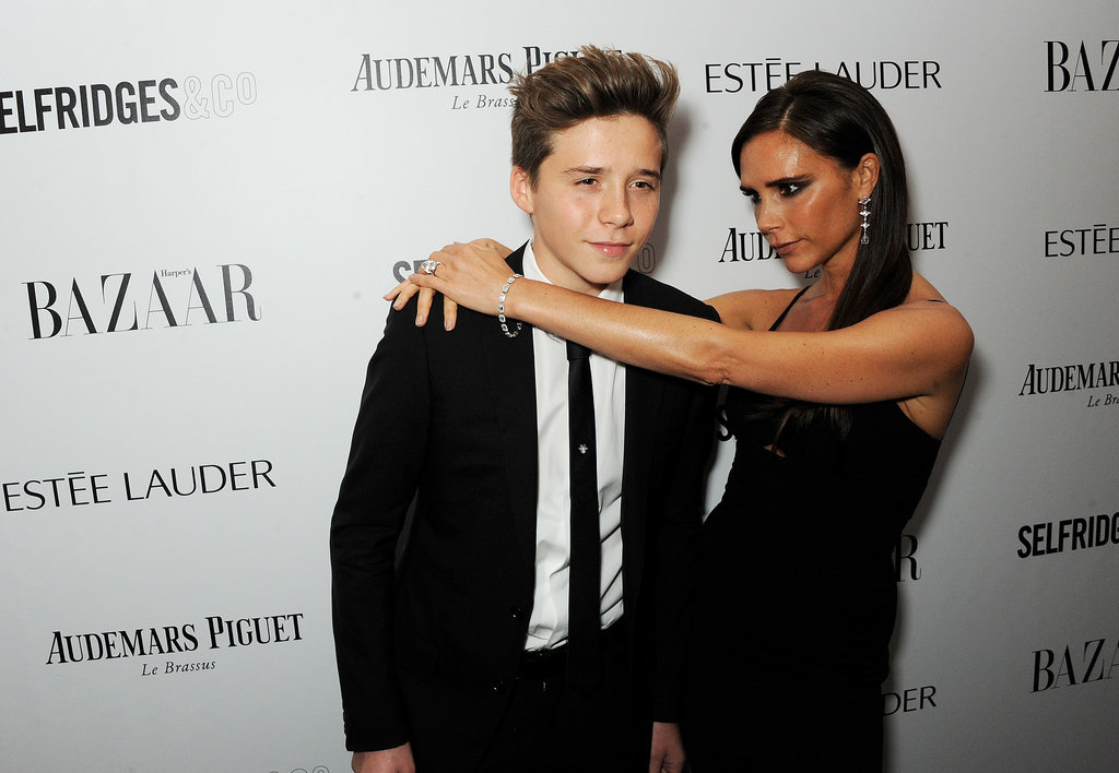 Victoria Beckham affectionately wrapped her arms around her son Brooklyn on the red carpet at the Harper's Bazaar Women of the Year Awards.